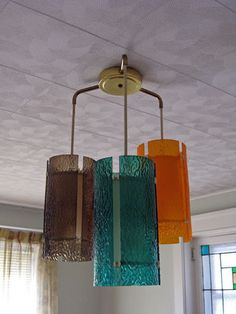 Lovely mcm hanging pendant lights!