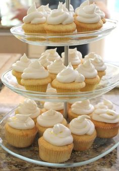 Simple to do yellow moist cupcakes in a tower #wedding #weddingcupcakes #cupcake #cupcaketower #yellow