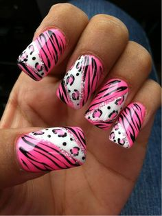 Animal print nail art design in pink,white and black with glitter details