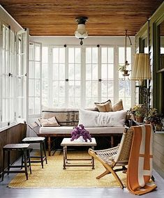 different ways to use your porch: long bench and stools for seating, perhaps leaving room for some play or dining space.