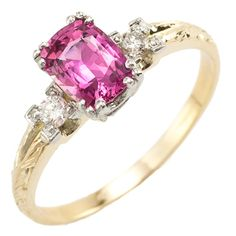 Watemelon Sugar: Go ahead take a bite! This vivid pink cushion shape sapphire reminds us of ripe watermelon picked at the height of summer. A sprinkling of two sugary diamonds on the shoulders adds a sweet sparkle and a bright yellow gold hand engraved mounting warms the ring to just the right temperature. Truly the perfect treat. Maloys.com