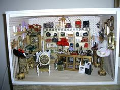 this lovely ladies shop, was created by me, I made all the hats, jewellery and painted the furniture