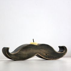 Moustache / mustache candle holder - Rodrigez -  made out of solid wood hand sanded and painted with black acrylic paint. €19,00, via Etsy.