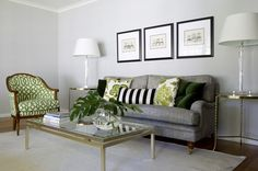 living room - love the green chair, the sofa is lovely and the black and white cushion sets it off perfectly.  This is such a lovely room.