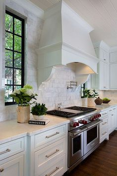 Kathleen Kellett Interiors, Atlanta windows on either side of range hood, range hood detail