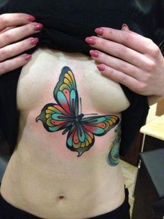 Vivid Butterfly chest tattoo