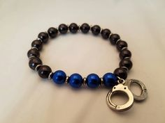 Blue line beaded stretch bracelet with handcuff charm|police wife|support police officers|handcuff bracelet|thin blue line|love|black blue by YaYouAlways on Etsy