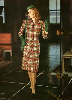 Model wearing a plaid summer suit by Dan River. Charm Magazine, May 1945. Ohoto by Farkas / Conde Nast.