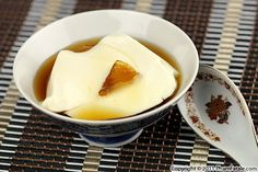 Tau Hu Nuoc Duong – Tofu Dessert in Ginger Syrup -1 (10oz) chunk fresh ginger -2 clementines -2c clementine juice (or orange juice), freshly squeezed (without pulp) -2/3c granulated sugar -1lb fresh silken tofu, store-bought