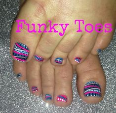 Pretty pedicure: a Blue polish with an abstract design painted with Hot Pink, Black and White.