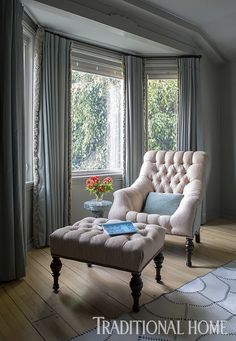 In a light-filled bump out, a tufted chair and ottoman provide a lovely place to read. - Photo: Teri Lynn Fisher / Design: Frances Merrill