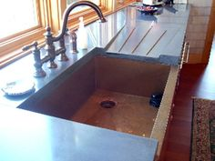 Interesting:  integrate a drain board into the granite. Not quite this conspicuous though.