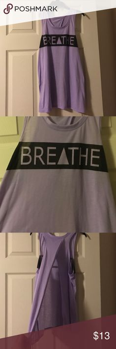 """""""Breathe"""" workout top Lilac colored workout top with slit in the back. If you like this, I have two other shirts like this in my closet in different colors and prints. Check them out!! ☺️ Tops Muscle Tees"""