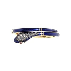 Victorian Era Blue Enamel & Diamond Snake Bangle, Circa 1860. Old mine cut diamond in head and ruby eyes.
