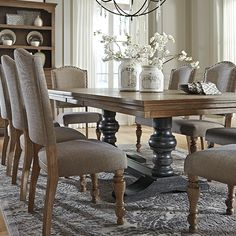 Details Vintage inspiration with a softer side, Tanshire dining room table sets the stage for rustic refinement. Distressed finish with wire-brushed detailing is deliciously different. Double pedestal base with baluster posts and a connecting stretcher are finished in a contrasting black for a wonderfully complementary look.