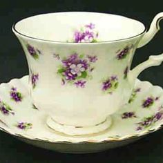 Teacups with violets...Sweet Violets by Royal Albert......my china pattern