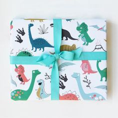 A set of three (3) rolled sheets of gift wrap, illustrated with illustrated with not so fearsome dinosaurs. Printed in full color on thick, luxurious paper. Can be used to wrap a special gift, and als