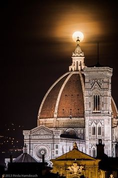 The cross atop the dome of the Cathedral of Florence aligns perfectly with the moon.