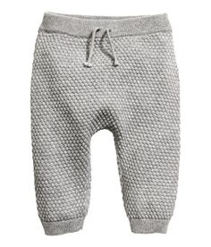 Check this out! BABY EXCLUSIVE/CONSCIOUS. Moss-stitch knit pants in soft, organic cotton. Elasticized waistband with decorative tie. Ribbed hems. - Visit hm.com to see more.