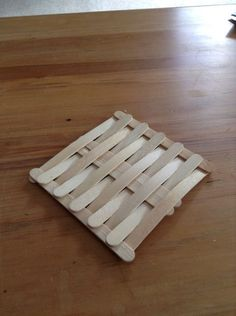 These are step by step instructions on how to make an awesome Popsicle stick coaster. You will need 16 Popsicle sticks in total to make it Popsicle sticks will break so take as many as you can. Popsicle Stick Coasters, Diy Popsicle Stick Crafts, Popsicle Stick Houses, Popsicle Crafts, Pop Stick, Stick Art, Wood Crafts, Fun Crafts, Ice Cream Stick Craft
