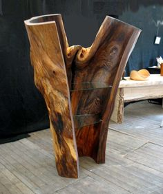 Hollowed out log cabinet with glass shelves