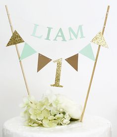 Custom 1st Birthday Cake Topper  add a unique and personalized topper to your babys first cake.   Made of premium glitter gold cardstockand, pastel color cardstock and food safe bamboo stick  MEASUREMENTS: - around 7 wide   ----------------------------------------------------------------------------------------------------------- SHIPPING  *This item is MADE TO ORDER and ships in 5-7 business days from purchase…