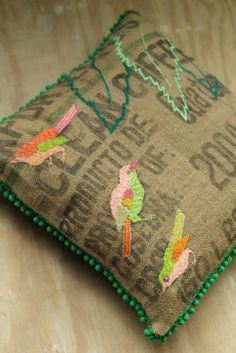I've been thinking of all the things I could do with old burlap from coffee bags. This is a great idea. I think I would do the embroidery to match the nature in the coffee's country of origin.