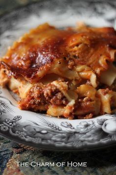 The Charm of Home: Slow Cooker Lasagna: I added a yellow onion while browning the meat, swapped the ricotta for cottage cheese, and added a can of diced tomatoes and extra water to make up for the difference in size between my jar of sauce (24oz) and the recipe's size (28oz).  You could easily swap the ground beef for ground turkey.  It was delicious!