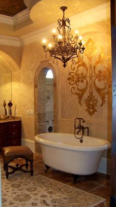 Tuscan Bathroom - adore the chandelier and wall art!!!