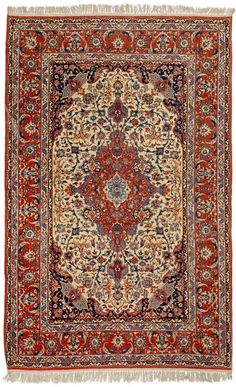 ISFAHAN old.  White central field with a red central medallion and dark-blue corner motifs. The entire carpet is finely patterned with trailing flowers and palmettes. Red border, In good condition.  151x234 cm