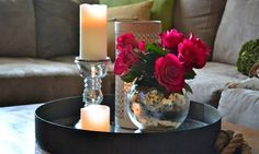"Tray,Candles, and Flowers in a Round Vase. (""Beautiful Red Rose In Globe Glass Vase And Silver Candle Holder On Black Round Tray As Sweet Coffee Table Decor Also Gray Fabric"")Sectional Couch And Cushion As Inspiring Romantic Living Room Decoration Views Coffee Table Styling, Decorating Coffee Tables, Tray Styling, Dinning Table Decor Ideas, Livingroom Table Decor, Coffee Table Decor Living Room, Red Living Room Decor, Dining Room, Dining Chair"