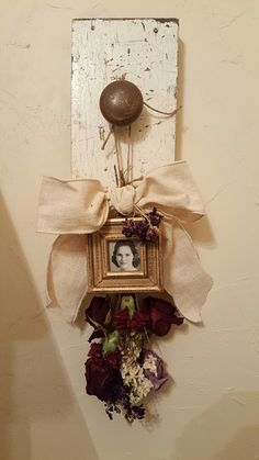 I wanted to find a special way to use flowers from my moms funeral. I dried the flowers then attached a frame and bow!