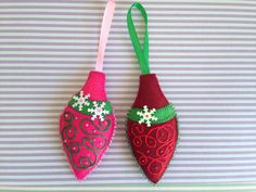 Set of 2 beautiful felt Christmas ornaments. Hand embroidered and hand stitched. Measures approximately 4.5 x 2.5.