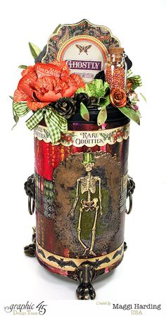 Here's a great and fun Halloween piece made from an altered cookie tin. Process video included in the link.
