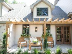 """The new pergola-covered porch (The antiqued finish on the bricks is known as a """"German schmear."""")"""