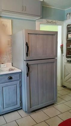 Refrigerator transformation DIY Adding Barn wood panels to outdated fridge.