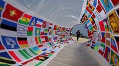 Annual big kite festival in Japan. This kite is decorated with international flags.