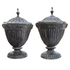Pair of 19th Century Lead Covered Urns | From a unique collection of antique and modern planters and jardinieres at http://www.1stdibs.com/furniture/building-garden/planters-jardinieres/