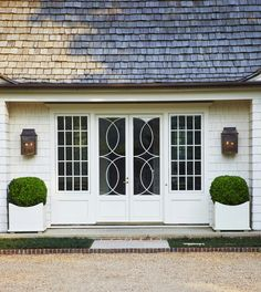 From the boxwood to the cedar roof, this unique front entry from is picture perfect. Traditional Home Exteriors, Traditional House, Anna Evans, Cedar Roof, Southern Homes, White Houses, Architecture Details, Windows And Doors, Curb Appeal