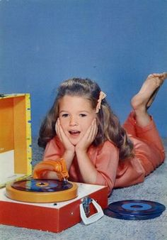 One of my favorite things to do as a kid.  Loved my record player and records!