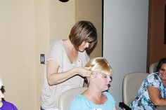 """Cancer patient Melanie McBee tries on a wig during the """"Look Good, Feel Better"""" program. Volunteer Adrienne Mayo helps McBee fit the wig.    """"Look Good, Feel Better"""" is an opportunity for cancer patients to receive tips on how to improve their physical Tips on how to loose Weight Look better  Feel Better change habits more at HFDW"""