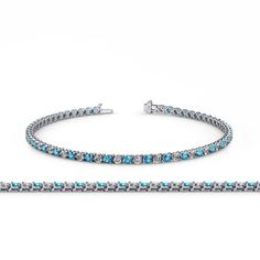 London Blue Topaz and Diamond (SI2-I1, G-H) 3-Prong Tennis Bracelet 2.15 ct tw in 14K White Gold. 33 Round Diamond of 0.99 ct tw & 33 Round London Blue Topaz of 1.16 ct tw set using 3-Prong Setting. SI2-I1-Clarity, G-H-Color Diamond & SI1-SI2-Clarity, Blue-Color London Blue Topaz. Gemstones may have been Treated to Improve their Appearance or Durability & may Require Special Care. The Natural Properties & Composition of Mined Gemstones define the Unique Beauty of each Piece. The Image may...