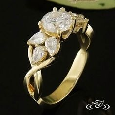 custom 18kt yellow prong set 1ct diamond with twist mounting there are two clusters of pear shaped diamondcustom engagement ringsprong - Non Traditional Wedding Rings