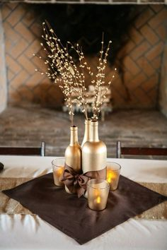 Center pieces, this would be awesome with black bottles, silver spray coming out the top and yellow bow and material : )