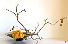 My Japanese friend just shared with me the art of flower arranging, ikebana, she learned from her grandmother. Very lovely.