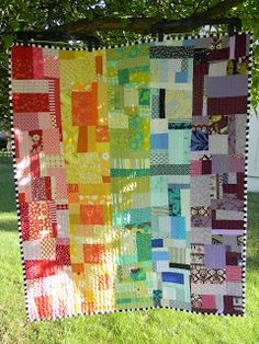 Rainbow Quilt made from monochromatic rows of scraps