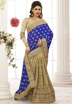 Buy Blue and Beige Faux Georgette and Net Saree with Blouse online, work: Embroidered, color: Beige / Blue, usage: Wedding, category: Sarees, fabric: Georgette, price: $217.88, item code: SAS882, gender: women, brand: Utsav
