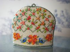 Rose trellis tea cosy. Inspiration for a piece I'd like to do with ribbon roses.