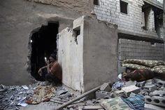 A Free Syrian Army fighter communicates using a walkie-talkie in the Mouazafeen neighbourhood in Deir al-Zor, June 14, 2013. Picture taken June 15, 2013. REUTERS-Khalil Ashawi
