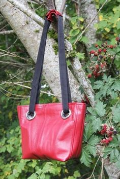 Leather Grommet bag constructed from the bottom of a leather jacket. Free Tutorial. Nice! Thanks crafty Staci